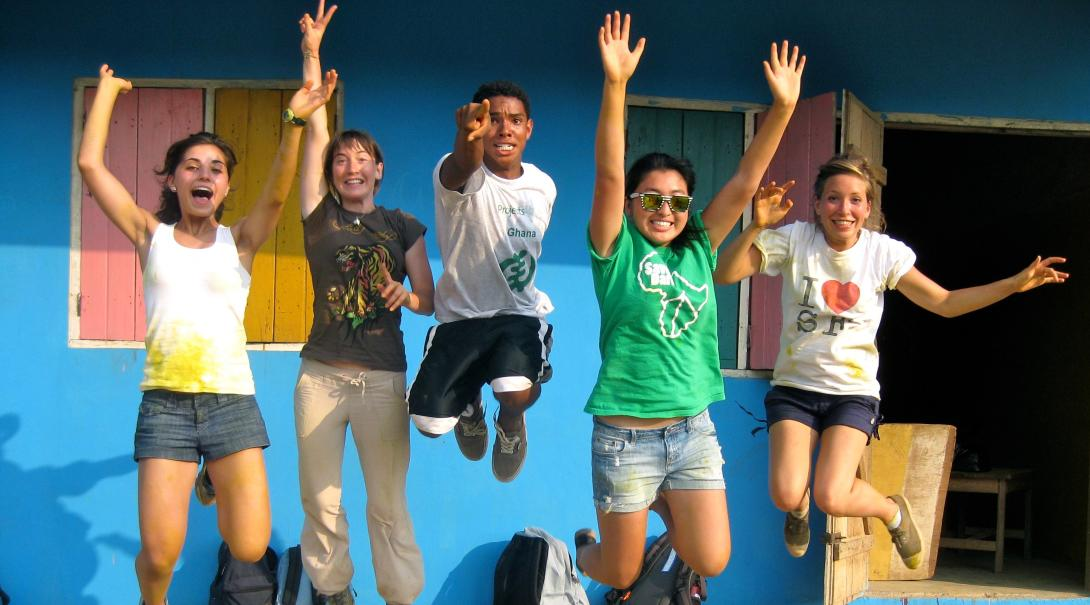 Group photo of volunteers after painting a local school in Ghana during their community volunteer work for teenagers.